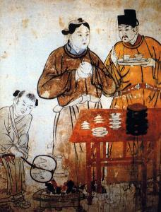 Depiction of a man, woman and child preparing tea in a mural in the tomb of Zhang Gongyou, Xuanhua